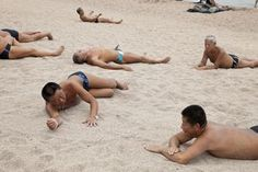 CHINA. Shandong Province. Qingdao. People enjoying the Beach. 2010.