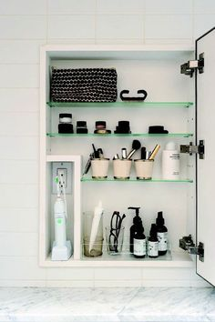 Placing an outlet in a medicine cabinet is a clever design for a bathroom.