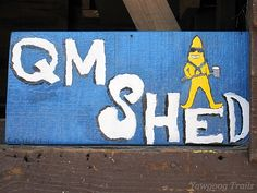 Sign for the Camp Sandy Beach Quartermaster Shed, painted by C. McPhee. On the Orange Trail at Camp Yawgoog, Rockville, Hopkinton, Rhode Island (RI).  A 2014 image by David R. Brierley.