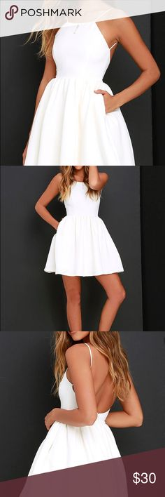 Lulu's Chic Freely Backless Skater Dress in White - Never been worn  - Sightly stretchy woven fabric falls from slender straps to a squared-off neckline - Features a backless, princess-seamed bodice - Gathered, fitted waist that opens into a tulle-lined skirt with side seam pockets - Fully lined. - 100% Polyester - 34 inches from shoulder to hem  - Can be worn with adhesive bra, petals, or no bra - Great for cocktail parties and formal occasions Lulu's Dresses Mini