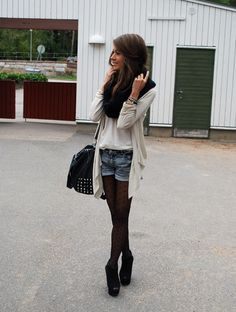 Tights + shorts + cardigan + fitted basic tee + ankle boots + scarf + bag.