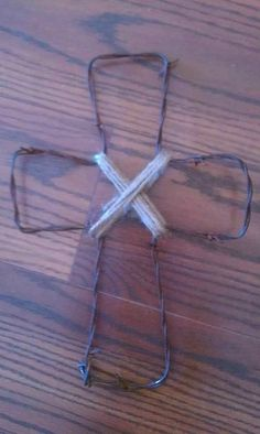 Items similar to Rustic Western Barbed Wire Cross with Jute (set of on Etsy Barb Wire Crafts, Wire Hanger Crafts, Wire Hangers, Burlap Cross, Rustic Cross, Wire Crosses, Wooden Crosses, Barbed Wire Decor, Cross Art