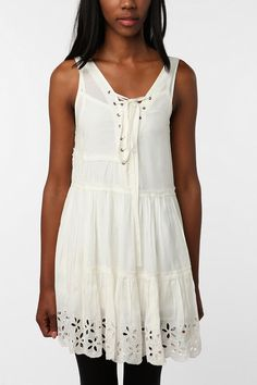 white dress with lace up front! LOVE!