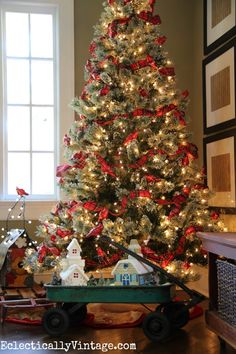 Themed Christmas Trees - love this tree with a flock of red cardinals perched in the branches and the surprise underneath! eclecticallyvintage.com