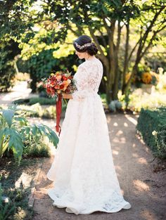 Romantic lace garden inspired wedding dress: http://www.stylemepretty.com/2015/12/14/european-inspired-garden-wedding-shoot/   Photography: Kristin La Voie - http://kristinlavoiephotography.com/