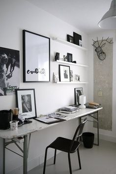 Thin Desk with awesome artwork on the wall