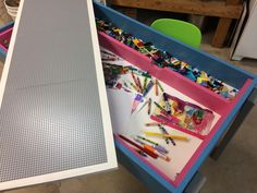 Kids Lego & Art table. 4'x2'x2'  with melamine top that has Lego sheets glued to it. Top flips to reveal smooth surface for art projects. Inside tray stores art supplies. Outer tray easily accessible for storing Lego pieces.