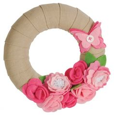 cover a wreath with burlap ribbon and use felt flowers to adorn it. How cool in a little girl's room!