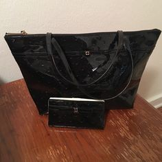 Kate Spade matching wallet and bag Kate Spade matching black bag and wallet. Wallet has never been used and bag was used lightly once. Perfect condition. kate spade Bags Totes