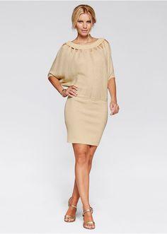 Skvostné! Sexy pletené šaty s prostřihy u výstřihu, celkovým vzorem a netopýřím horním dílem. Přiléhavá sukně, délka ve vel. 38 cca 90 cm. Vrchový materiál: 14% Kovová vlákna, 86% viskóza
