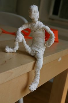 make a mummy - could be fun card holders for the table (different postures)