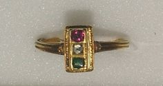 16th century.  Gold ring, the elongated rectangular bezel set with a pyramidal diamond between a ruby and an emerald, the hoop chased with fluting on the shoulders