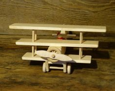 Handmade original design wood toy Alaska bush plane. 11 inches wide (wingspan) and 9 inches long, propeller spins, and comes with one little wood person that is glued into the cockpit. Made from pine, spruce, and glued together with non-toxic child safe glue. The plane has no oils, stains, or finishes applied to it. The bottom is wood burned with my initials CHH and 17 (year made) ). If you have any questions feel free to ask, thanks for looking.