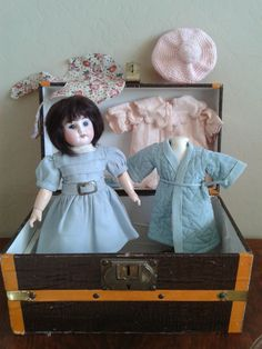 A darling blue eyed second series antique Bleuette marked 6/0 is in excellent condition with original Bleuette body marked 2 between the shoulders and