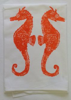 Kitchen gift: coastal beach kitchen towels with seahorses and other designs. Now on sale. $12.50
