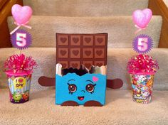 Shopkins centerpiece. Cups, bows & Valentine wands purchased from Dollar General. Cricut accent essentials & extreme fonts for 5's. Candy bar created from A1Amazon cardboard box, scrapbook paper & paper punches (circle-3, square & heart).