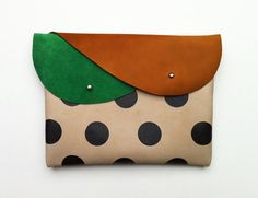 ITEM  • double flap closure clutch and iPad Mini Case  • the clutch is made of royal green, brown and warm grey coloured leather  • the black