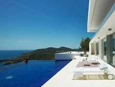 Perched above the Mediterranean at the highest elevation between the town of Santa Eulalia and the rest of the island of Ibiza, this expansive villa offers luxurious comforts, essential privacy, and unparalleled views of the sea. Architects at Minimum Arquitectura get credits for sculpting this paradise befitting a celebrity.