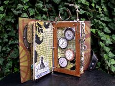 From An Octopus's Garden, by Ingrid Dijkers. [Love: steampunk theme, watch grid and wire embellishments. I'm salivating. Again!]