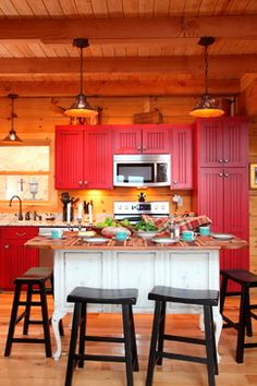 The Valentine's Day kitchen! Beautiful antique island, red cabinetry with heart shaped hardware and the overall comfort of a solid log home. Red Kitchen Cabinets, Kitchen Cabinet Design, Kitchen Dining, Cottage Kitchens, Rustic Kitchens, Interior Photo, Cozy Cottage, Log Homes, Traditional House