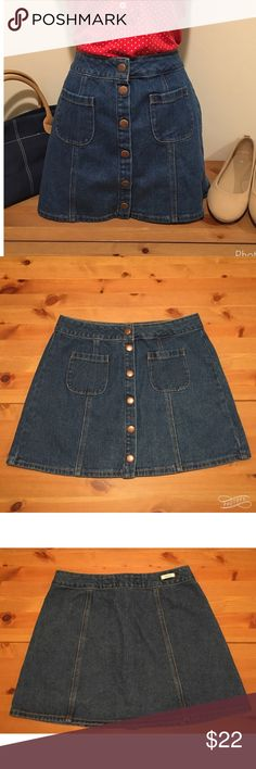"""Melville Retro 70's style Denim mini skirt Retro 70s-style high-waisted snap front denim miniskirt with classic front patch pockets. In excellent used condition with no rips, stains or odors. Slight A-line shape flatters your figure. Measurements: Waist 14"""" Length 14.5"""" Width across bottom 22"""". Size tag reads Melville 29 (but based on flat measurements, waist is actually 28 inches). Smoke free home. Save an additional 15% by bundling. Melville Skirts Mini"""