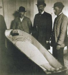 famous image of Jesse James, who was shot in the back by Robert Ford while adjusting a picture.