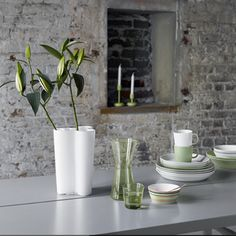 Classic Iittala tableware and vase. The Teema ranges in white and Celadon and Origo with the Kartio carafe and glass and Alto Vase, pure style....