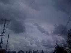 Storm clouds through wet windshield