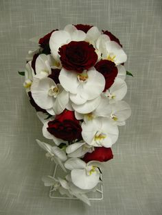 Classic cascading Bridal bouquet of White Phaelanopsis Orchids and Hearts roses.