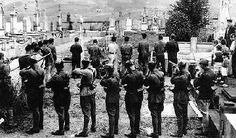 Communists and anarchists in their separate uniforms execute the bourgeoisie and priests in a Catalan cemetery during the Civil War.