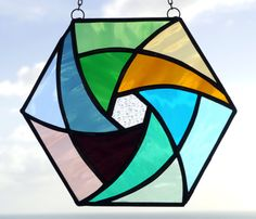 Stained+Glass+Geometric+Pinwheel+by+ReflectionsOfGlass+on+Etsy,+$55.00