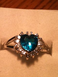 'Heart Shaped Aquamarine Ring size 7.5' is going up for auction at  7pm Mon, Oct 22 with a starting bid of $5.