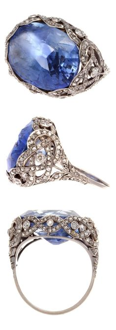 An Art Deco platinum, sapphire and diamond ring, USA, Featuring a natural Ceylon sapphire weighing approximately 15 carats, set to an intricate intertwining rows of platinum mount set with near colourless diamonds. Old Jewelry, Antique Jewelry, Vintage Jewelry, Fine Jewelry, Jewlery, Bijoux Art Deco, Art Deco Jewelry, Jewelry Design, Sapphire Jewelry