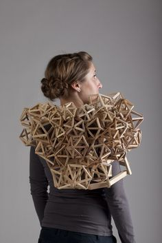 Wearable Sculpture - www.tracyfeatherstone.com Tracy has come up with an idea that fuses architecture, clothing and furniture altogether. These are the portable sculptures made of pieces of wood. The material takes the shapes that faces the flesh and follows the human body curves and finally binds the both of them. These structures are called wearable structures and are well conceptualized by Tracy.
