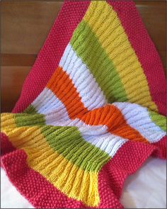 Soft and colourful, and an easy knit: the Snuggle Bug Baby Blanket by Mary Bonnette for The Sassy Skein.