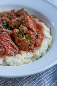 Delicious Slow Cooker Pork with Mashed Cauliflower! If you've never tried mashed cauliflower, you need to try this recipe! So EASY to make! Low carb, Whole30 and Paleo diet approved! #lowcarb #whole30 #paleo