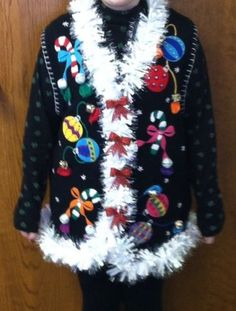 Ugly Christmas Sweater Vest | eBay $29 - 20 bids - Dec 10th - $5.80ship. This is a great ugly Christmas sweater vest! I actually won the contest at a work party last year with this sweater. The sweater is solid black and accented with ornaments. I added garland, bows, rhinestones, and jingle bells to the sweater. It is an adult size large