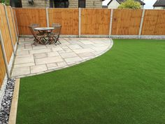 Easy maintenance back garden,  curved patio area with artificial grass surround.