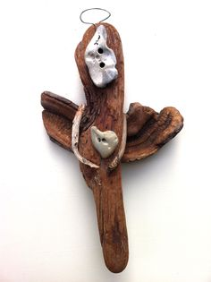 """""""Naturally, My Angel Holds My Heart""""  Driftwood Art by Mother Nature.    Handmade by Doctor Driftwood.  Made out of """"all natural"""" handpicked driftwood and stones """"reclaimed"""" from California. """"Where Nature and Style Meet.""""  Follow me at Facebook/DoctorDriftwood and Pinterest/DoctorDriftwood.  Look for me on Flickr/DoctorDriftwood.  Visit DoctorDriftwood.com for sales, more info, and harmony.  Enjoy Nature in your home.  Cheers!"""