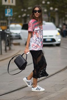 An oversize tee with a sheer skirt and sporty sneakers.
