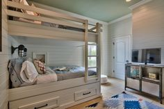 Traditional Kids Bedroom with Crown molding, Carpet, Wall sconce, Bunk beds, limestone tile floors