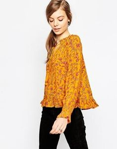 The cutest little tassel blouse