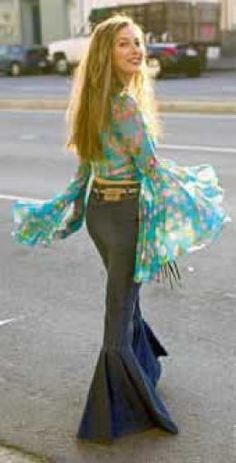 60's Bellbottoms.  I had a pair like this which were red with green and yellow flowers.  These blouse billowy sleeves were a pain,, but looked pretty.