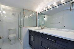NYC Bathroom. Love the bright reflective lights.