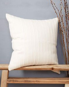 "Product Story The Recycled Stripe Pillow in Cream was handwoven by a family run co-op in Chiapas, Mexico. We used 100% cotton mixed with strips of recycled fabric waste to create a simple striped pillow with a bit of texture. Each stripe is slightly different, making each pillow totally unique. Product Details 20"" x 20"" & 24"" x 24"" 100% cotton Insert included Machine wash on cold, hang dry Due to the nature of handcrafted goods, slight variations are embraced Ethically made"