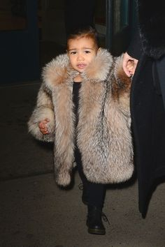 North makes below-freezing temperatures look luxe—even in the middle of a New York winter—in an oversized fur coat.