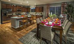 We love the wood floors and fun decor accents in this Lennar Colorado kitchen!