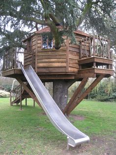 Childrens Treehouse with Slide | HIGH LIFE TREEHOUSES | Click on photo for link to more designs.