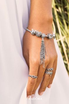 Welcome spring by adding filigree heart patterns and stylised tassel details to your wrist and fingers. The sterling silver and hand-crafted rings, charms and dangles are the perfect accessories for the upcoming season.