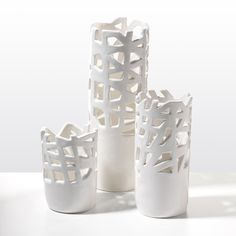 UnisonCutaway White Vases 45.00 – 85.00	  Like corals' modern cousins, these vases layer negative and positive space for organic flow. Chicago artist designer Susan Dwyer handmade each ceramic piece. They are available in three sizes.